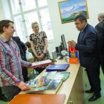 Jan Kamenický, Director of the Jan Palach Library, receives the book donation